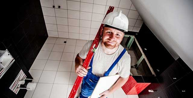 tradesman looking up with quote
