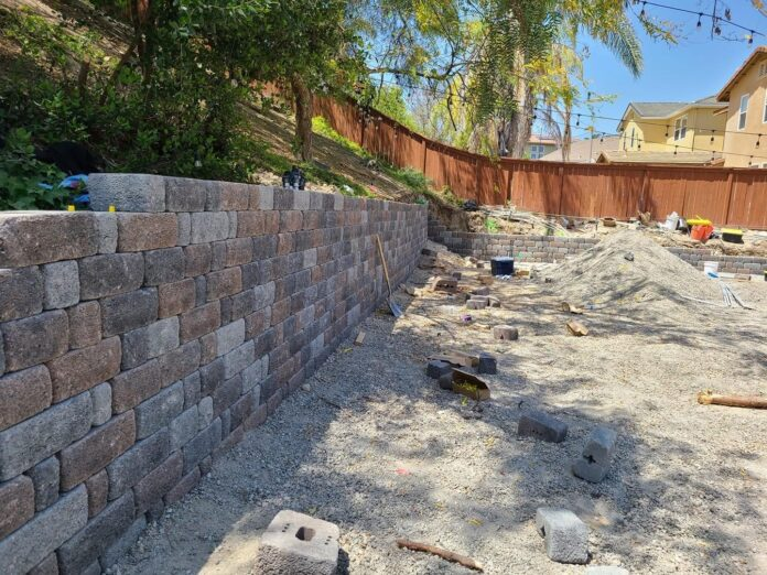 retaining wall being built in back yard
